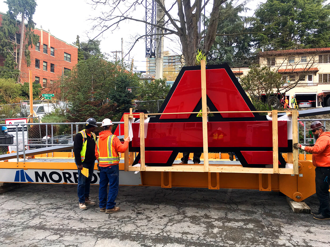 Mounting an Anderson Construction logo on a crane